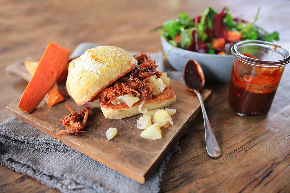 Pulled Pork Sandwich with Barbecue Sauce, Wild-Herb Salad and Sweet Potato Wedges